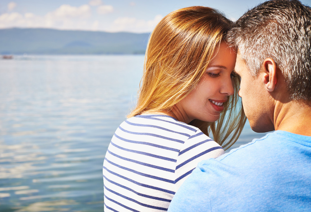 Affectionate Couple Spending Vacation At Lake