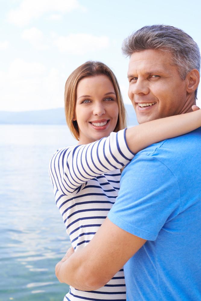 Happy Couple Embracing At Lake