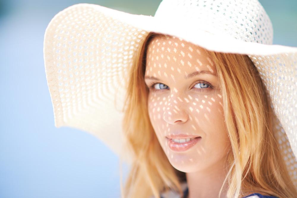 Portrait Of Beautiful Woman In Summer Hat