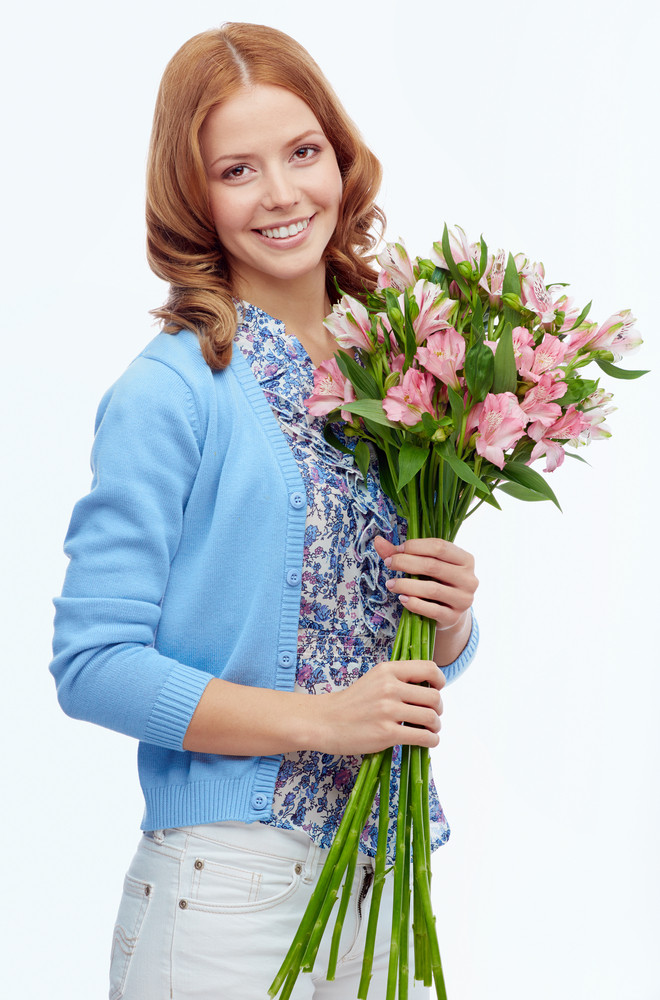 Portrait Of Smiling Female Holding Bunch Of Pink Lilies
