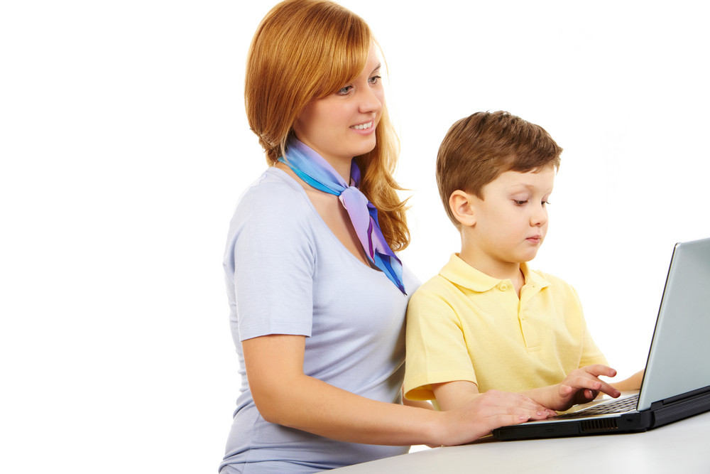 Portrait Of Woman Teaching To Type Young Boy