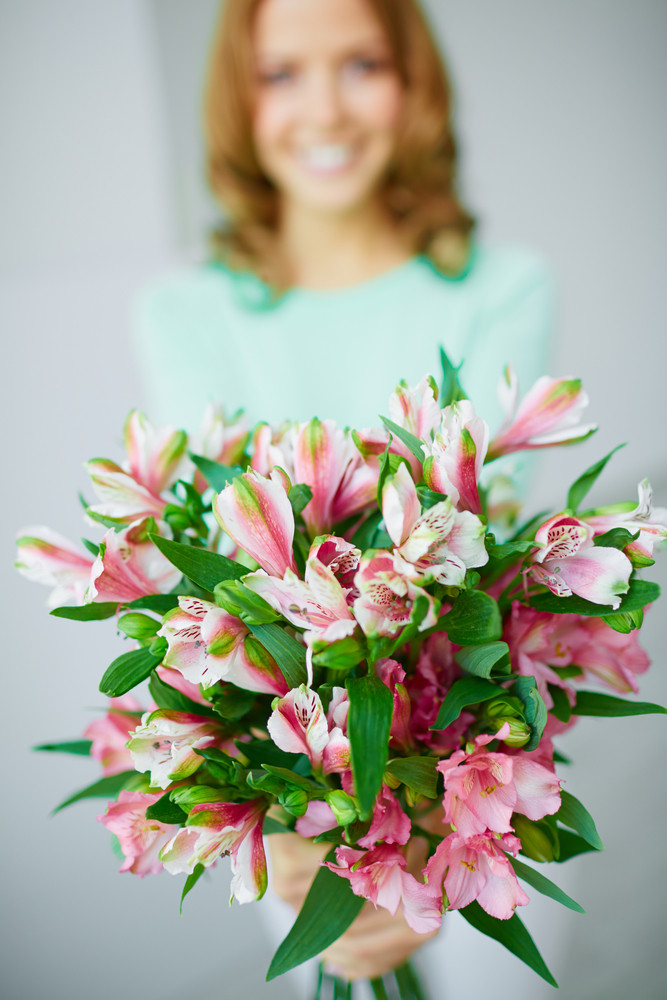 Close-up Of Bunch Of Pink Lilies Held By Female