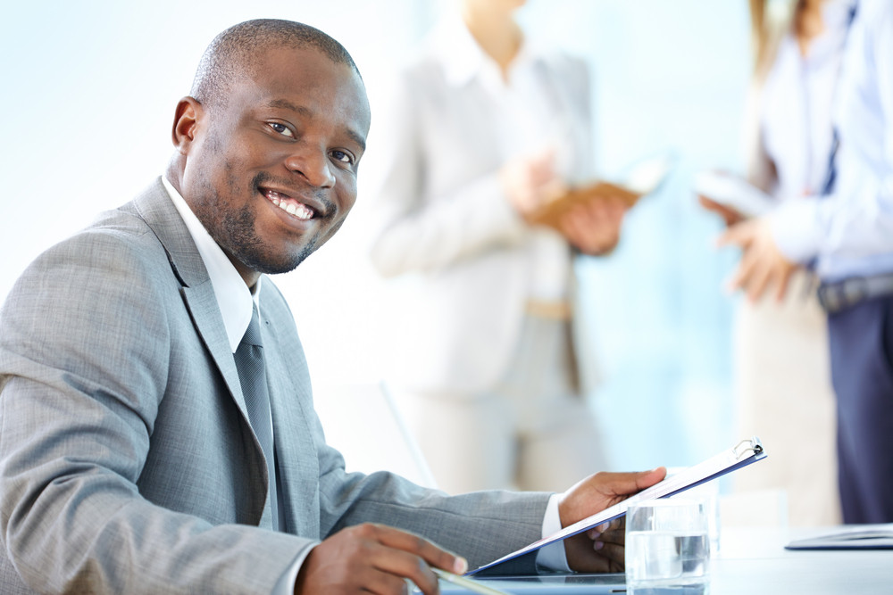 Portrait Of A Cheerful Business Worker Smiling At The Camera