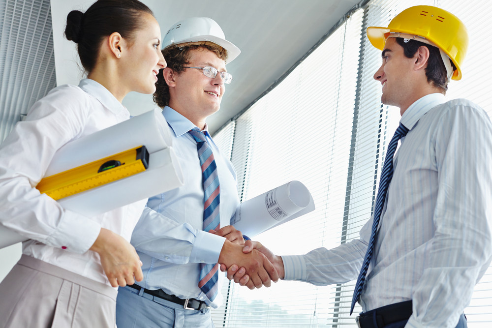 Three Architects Striking A Deal In Office