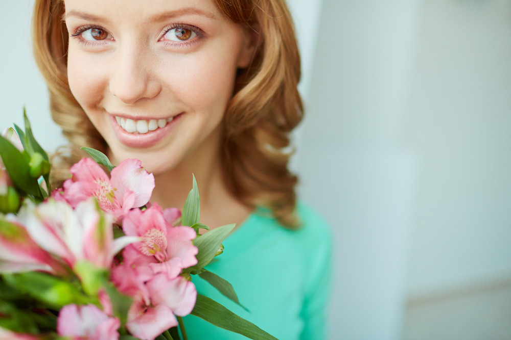 Face Of Pretty Girl With Pink Flowers Looking At Camera