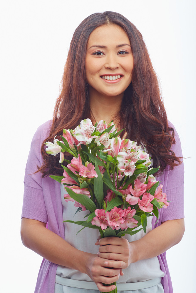 Portrait Of Positive Female With Bunch Of Fresh Flowers Looking At Camera