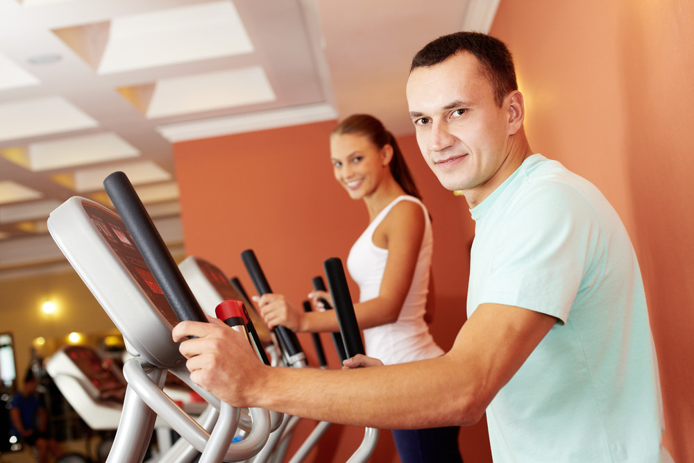 Portrait Of Young Man Training On Special Sport Equipment In Gym