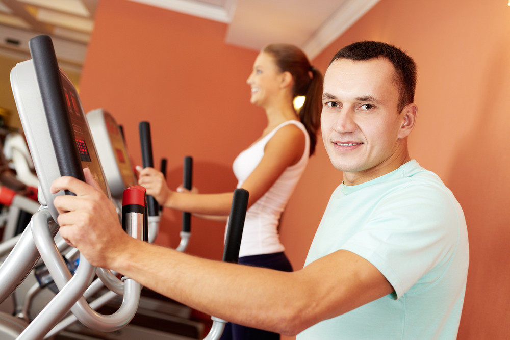 Portrait Of A Man Exercising In Gym