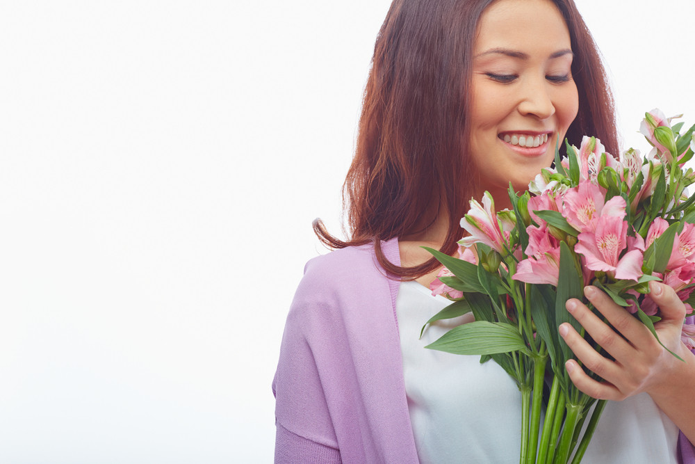 Portrait Of Charming Female Looking At Bunch Of Fresh Flowers