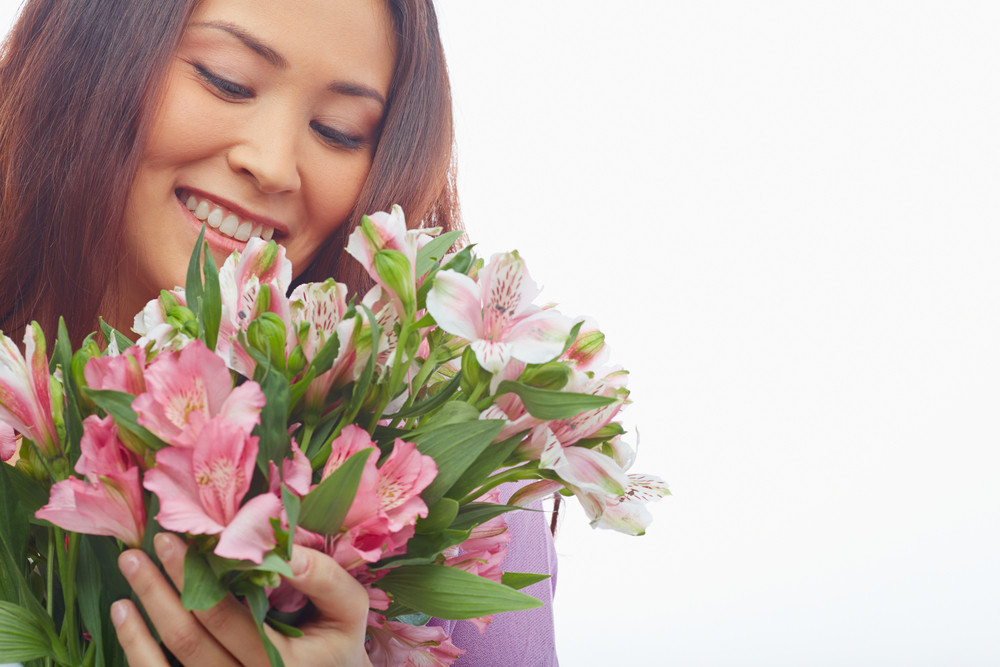 Portrait Of Charming Female Feeling Smell Of Fresh Flowers