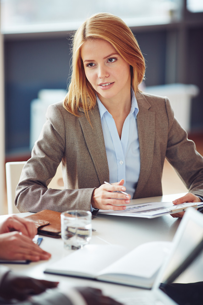 Elegant Secretary With Document Sitting At Business Meeting