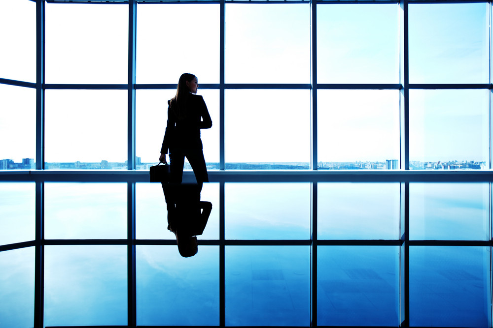 Outline Of Office Worker With Briefcase Standing By The Window