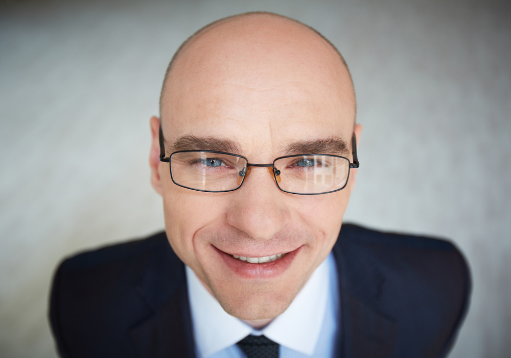 Face Of Attractive Businessman In Eyeglasses Looking At Camera