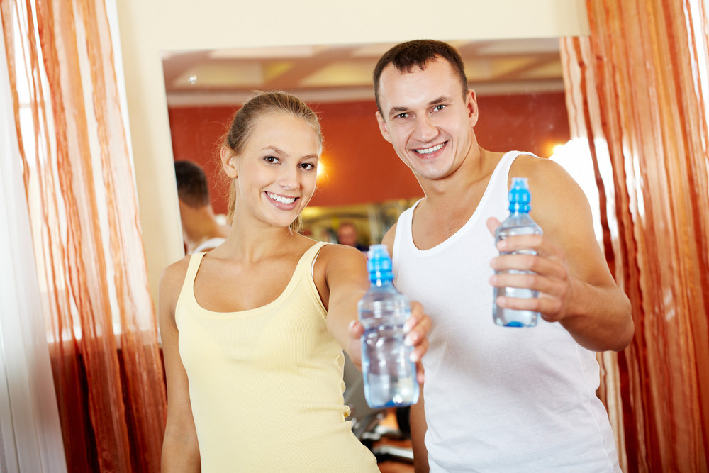 Portrait Of Happy Woman And Man Refreshing After Exercises