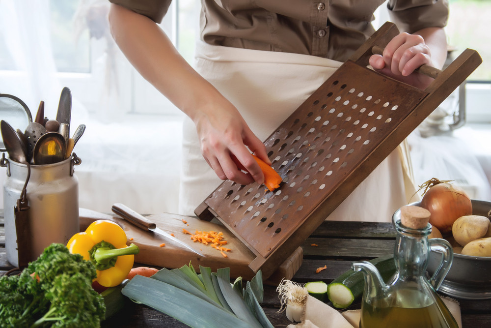 Woman Grate The Carrot