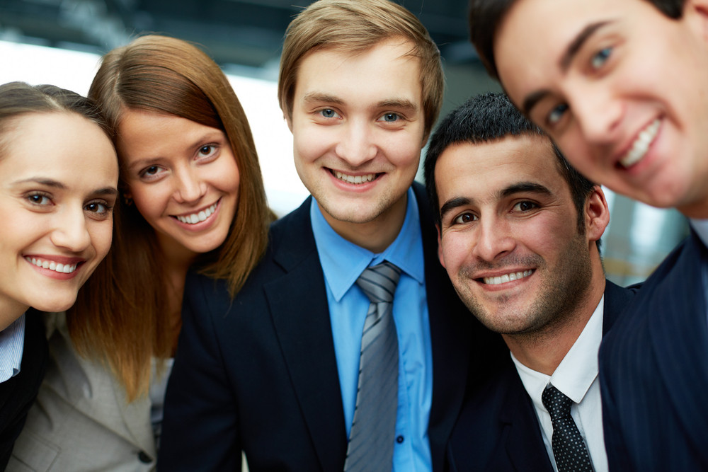 Portrait Of Five Business Partners Looking At Camera With Smiles