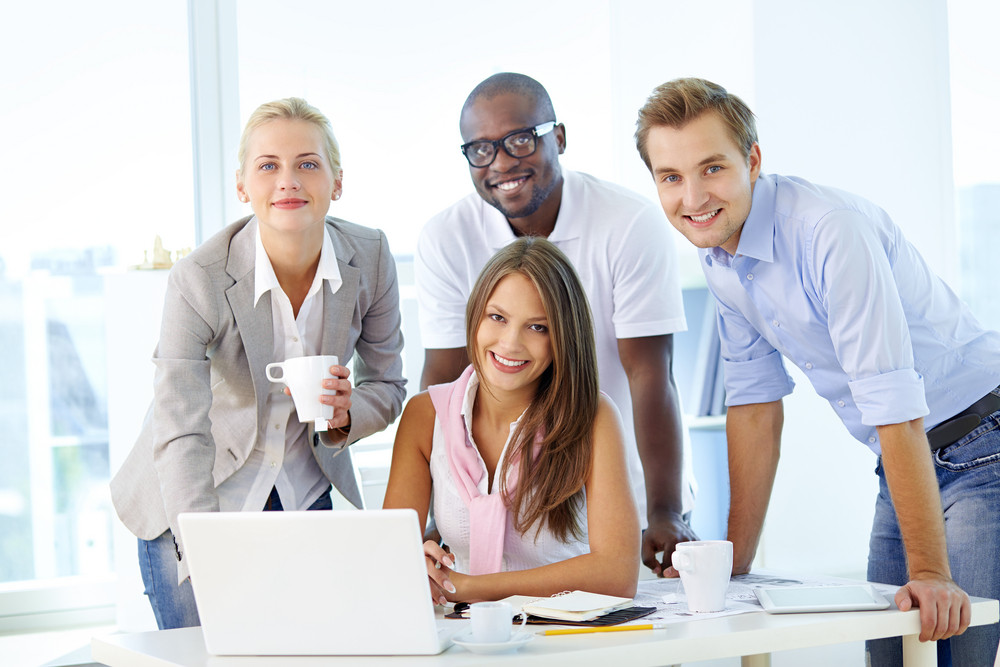 Friendly Young People Working As A Business Team