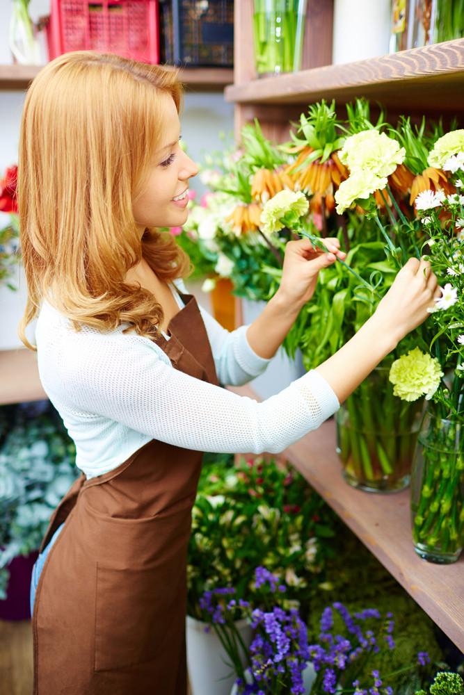 Portrait Of Young Female Florist At Work