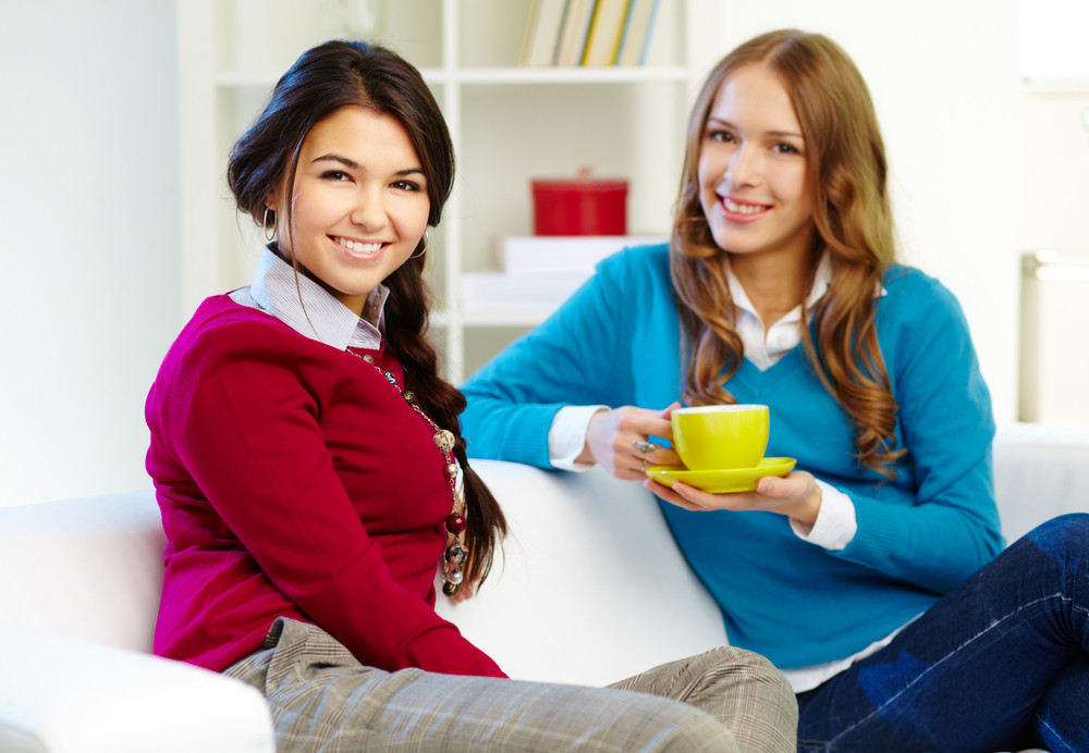 Portrait Of Young Females Looking At Camera At Home