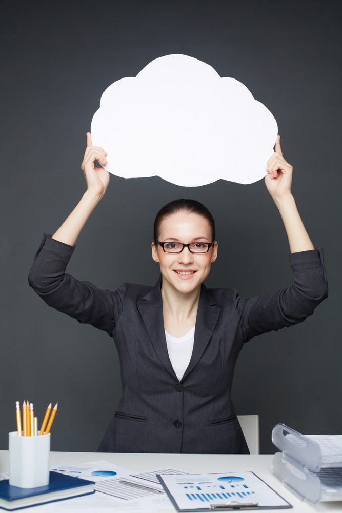 Image Of Pretty Businesswoman In Eyeglasses Holding Blank Paper Speech Bubble In Her Hands And Looking At Camera