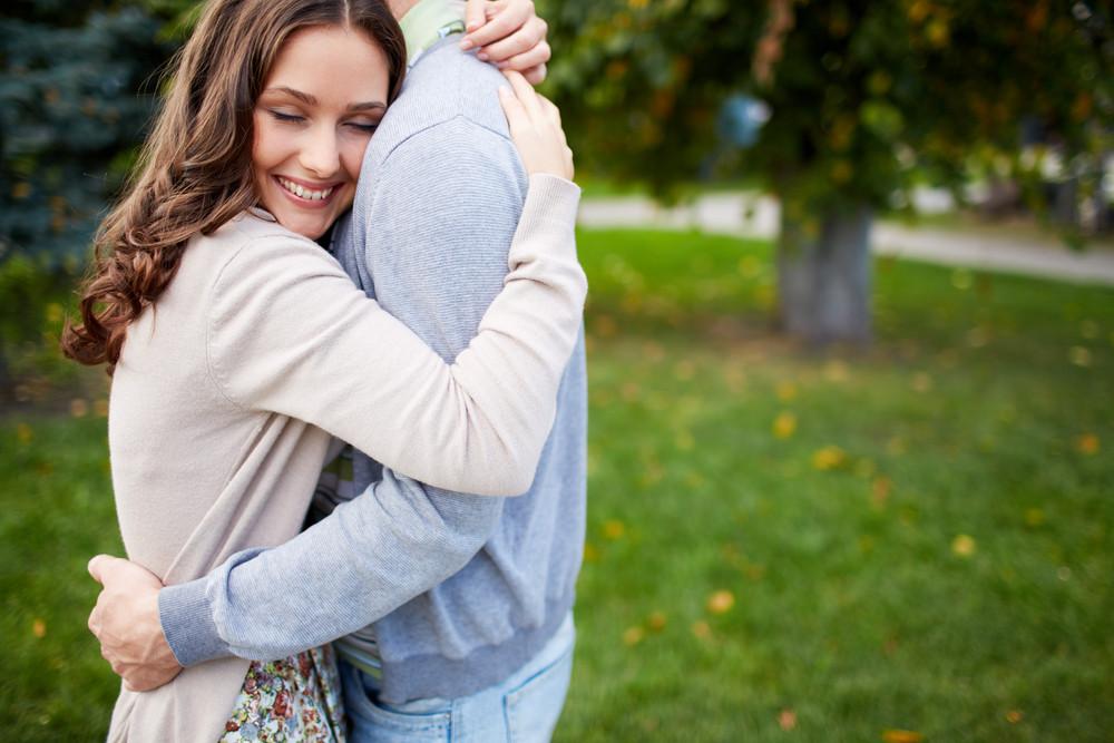Happy Girl Embracing Her Boyfriend In Park