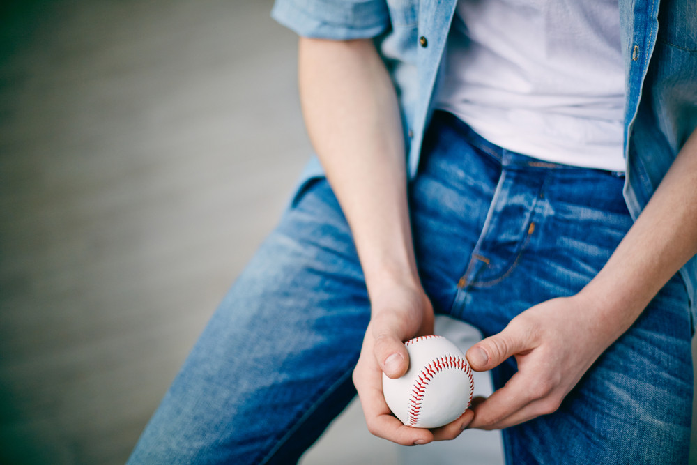 Hands Of Guy In Jeans Holding Tennis Ball