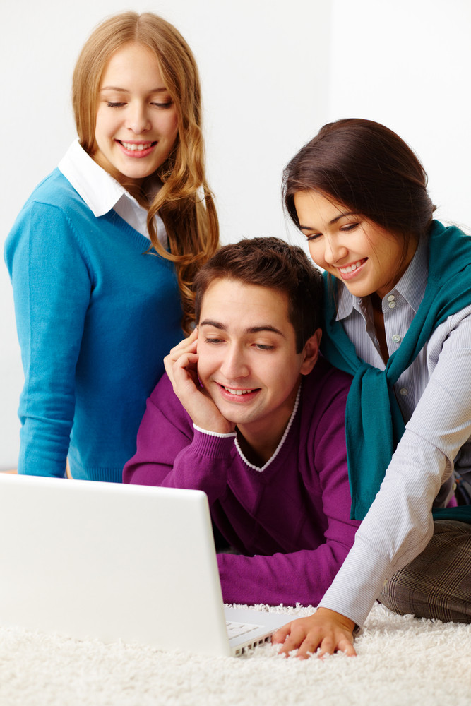 Portrait Of Attractive Friends Looking At Laptop Screen