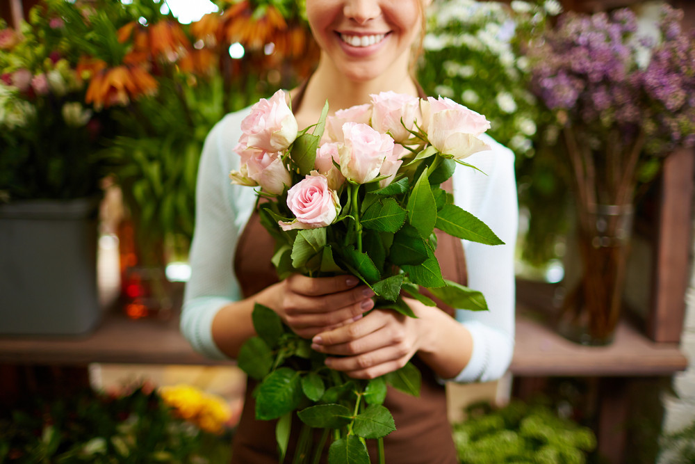Close-up Of Female Holding Bunch Of Pink Roses