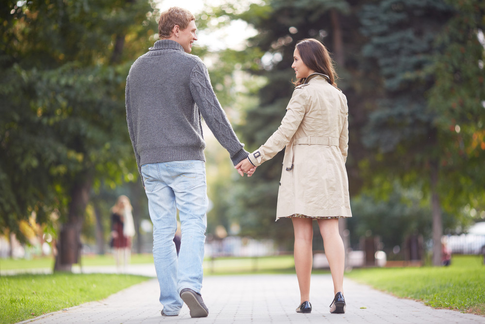 Young Happy Couple Walking In Park