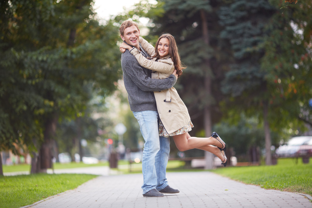 Happy Guy Holding His Girlfriend In Park