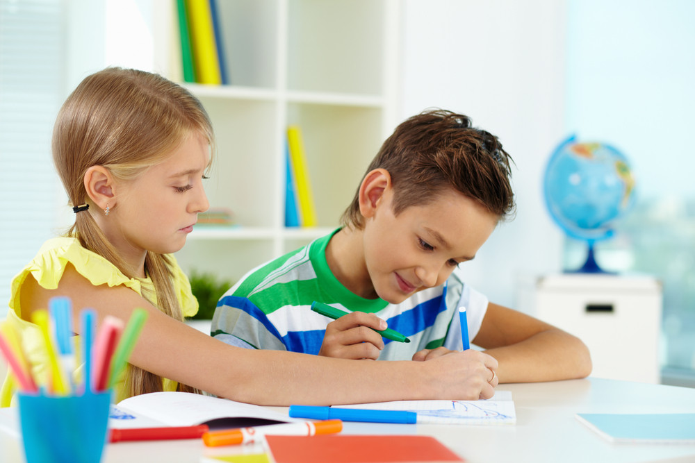 Lovely Girl And Her Classmate Drawing Together At Lesson