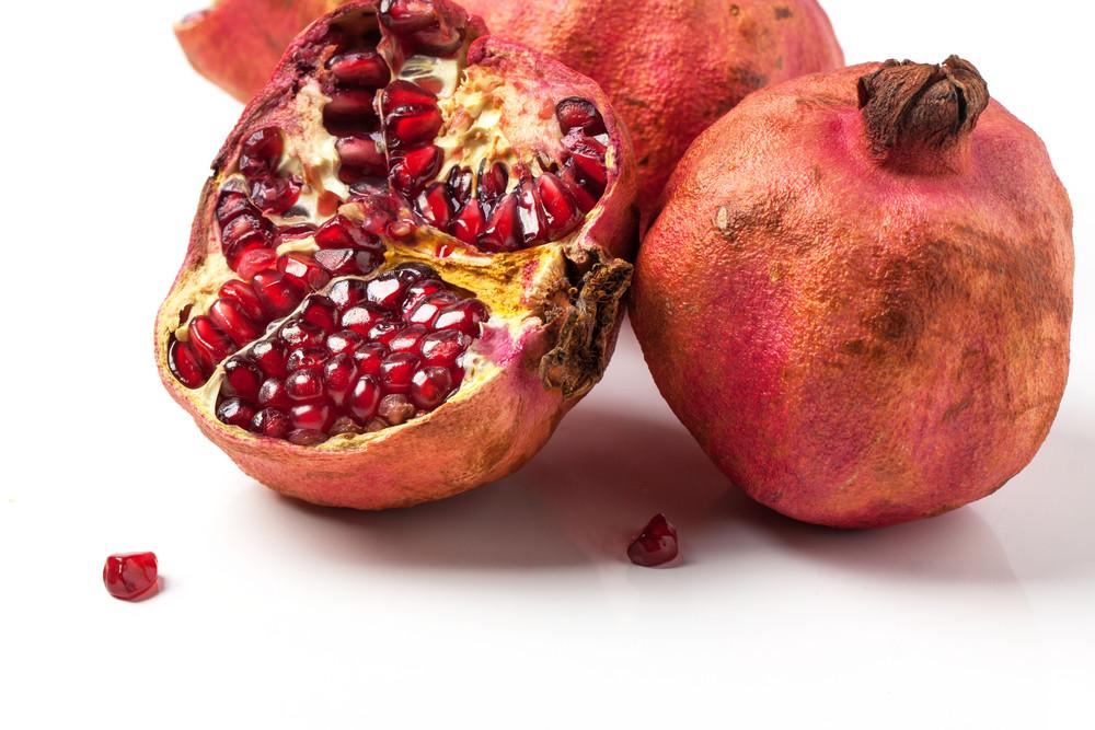 Pomegranates Over White