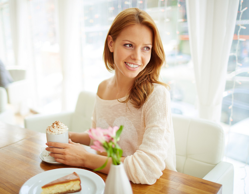 Image Of Young Female Enjoying Dessert In Cafe