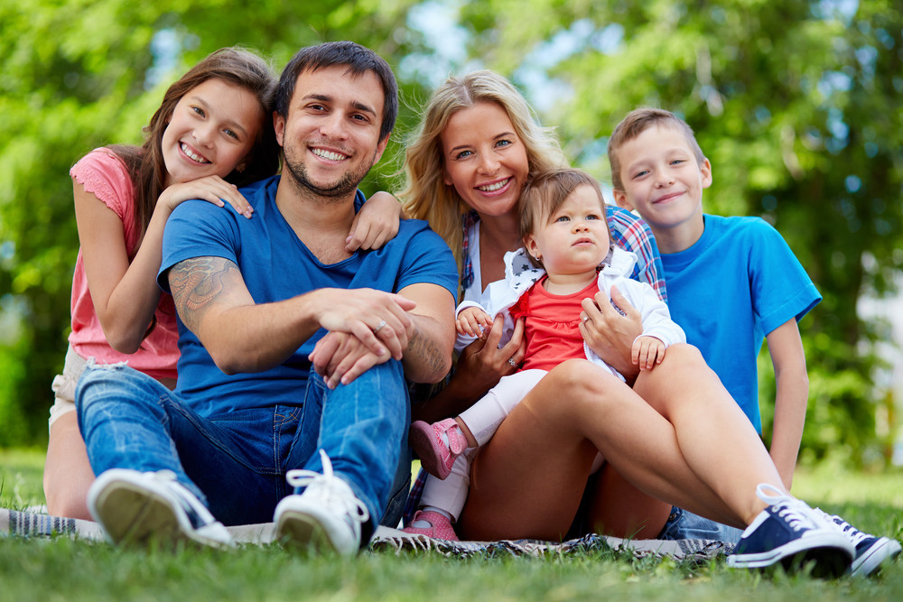 Photo Of Happy Family Looking At Camera Outdoors