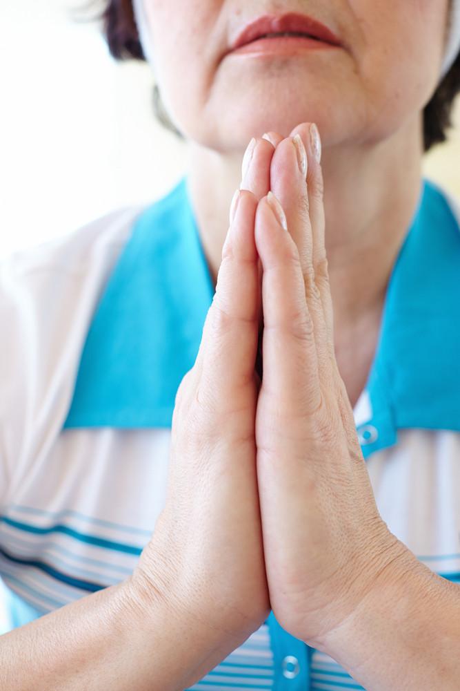 Close-up Of Aged Female Doing Yoga Exercise