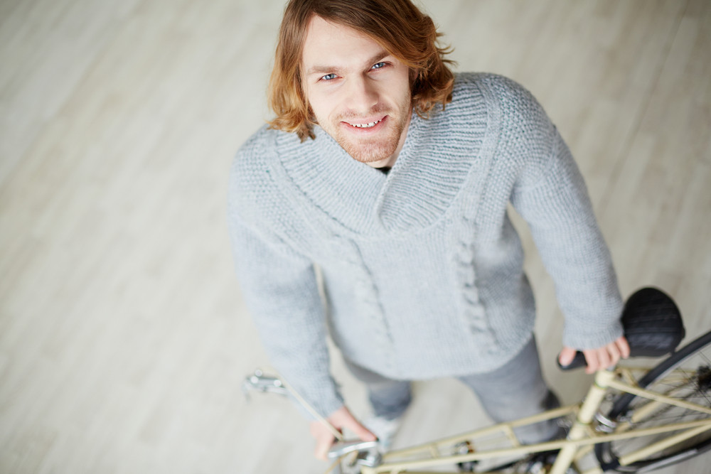 Handsome Man With Bicycle Looking At Camera