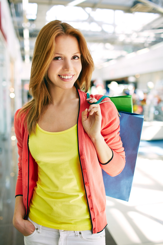 Portrait Of Happy Girl Holding Shopping Bags
