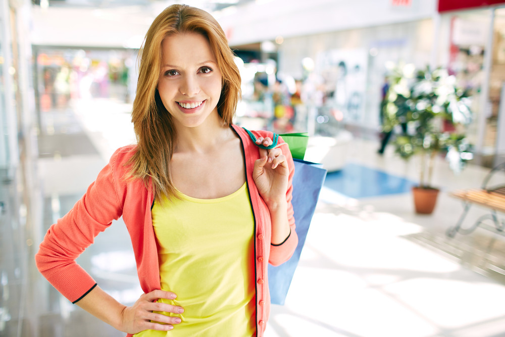 Portrait Of Pretty Consumer With Shopping Bags Looking At Camera