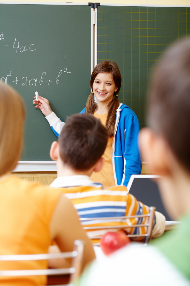 Confident Student Looking At Camera In Classroom