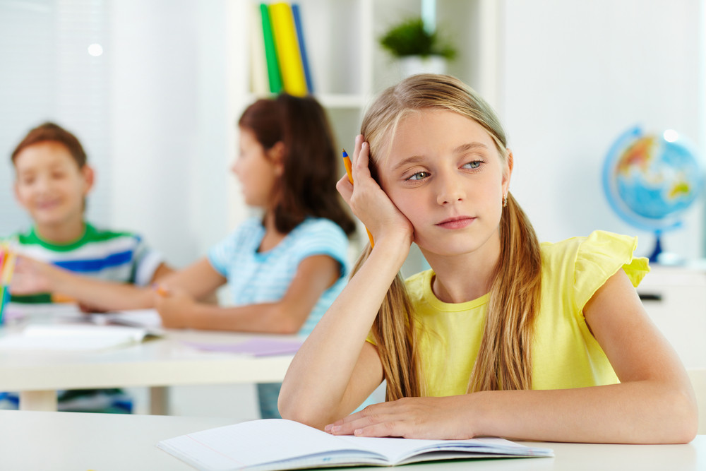 Lovely Girl At Workplace Thinking At Lesson
