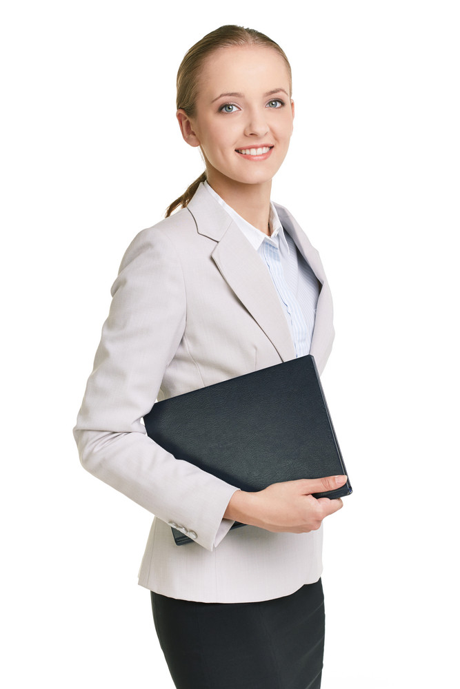 Portrait Of Young Businesswoman Or Teacher With Folder Looking At Camera In Isolation