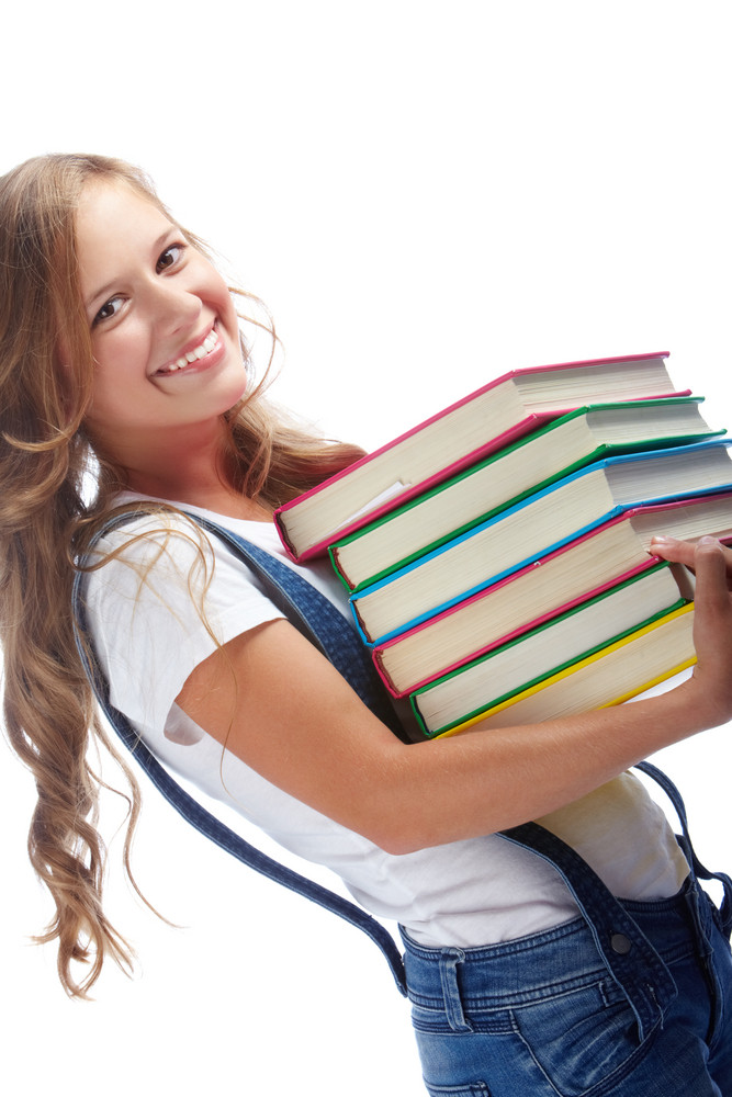 Cute Girl With Stack Of Books Looking At Camera In Isolation