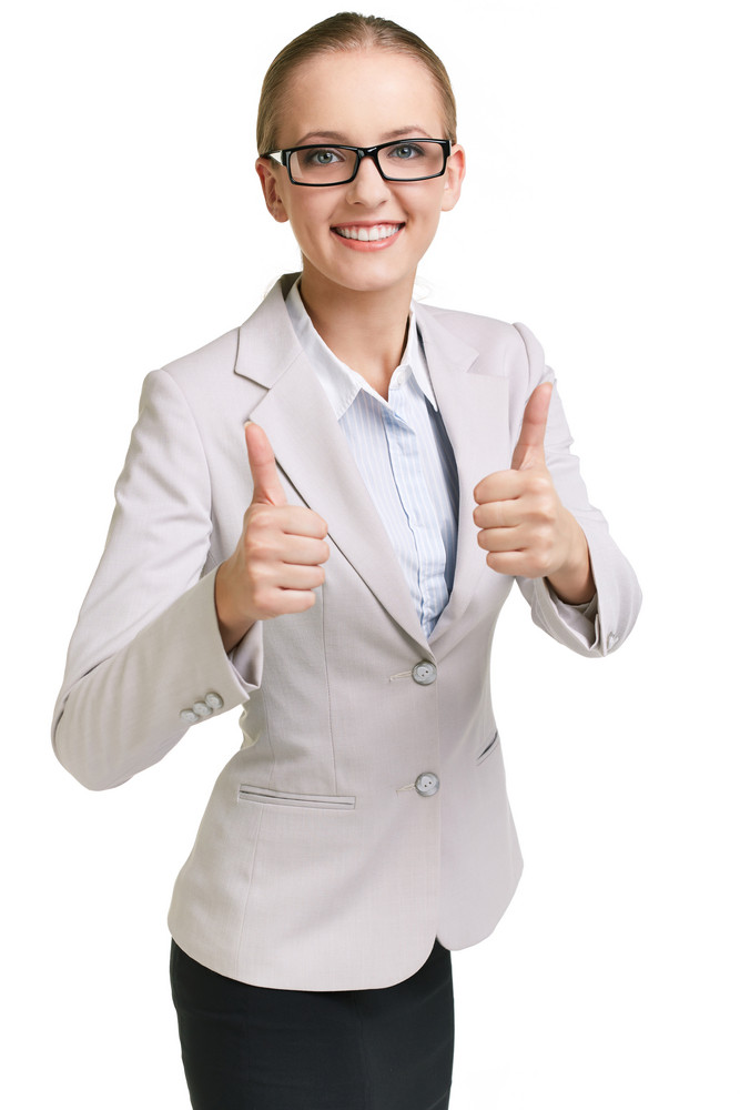 Portrait Of Young Businesswoman Showing Thumbs Up