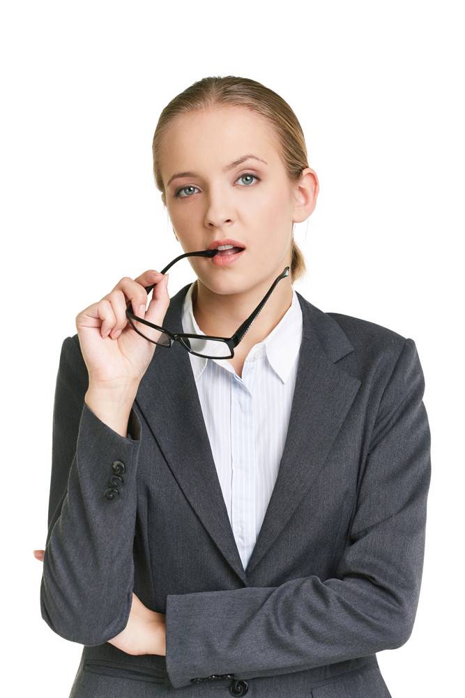 Portrait Of Young Businesswoman Or Teacher Looking At Camera In Isolation