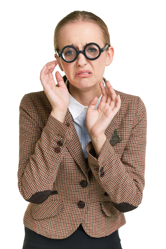 Portrait Of Unhappy Female Student In Eyeglasses Expressing Distraught
