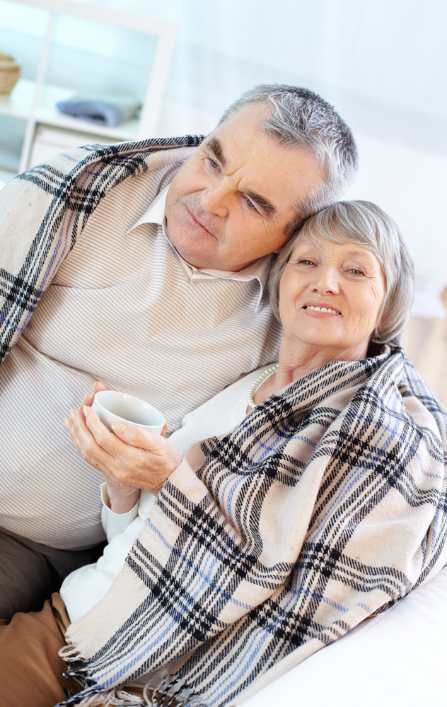 Portrait Of A Senior Couple Wrapped In Plaid