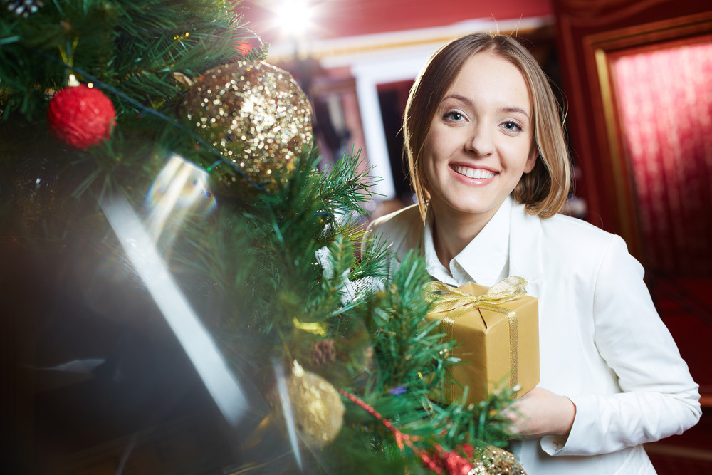 Pretty Businesswoman With Giftbox Looking At Camera With Smile