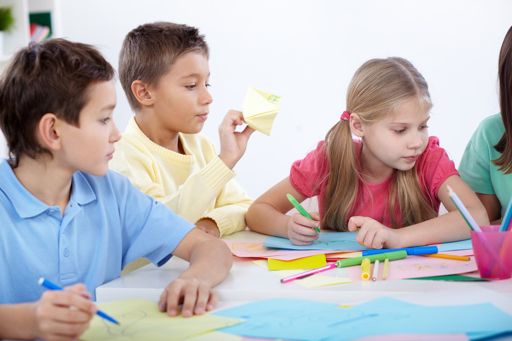 Smart Schoolboys And Schoolgirl Drawing With Colorful Highlighters