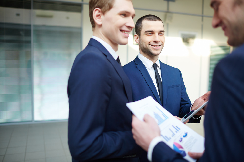 Image Of Three Young Businessmen Planning Work At Meeting