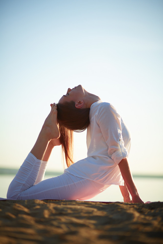 Photo Of Active And Fit Girl Doing Stretching Exercise Against Clear Sky